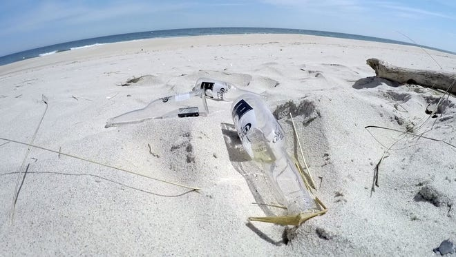 """Bottles are shown on the Sandy Hook beach Monday, April 13, 2015, near where Clean Ocean Action was announcing the """"Dirty Dozen' items collected during the 2014 beach sweep.    DIRTYDOZEN0413E    ASB 0414 beach sweeps  SANDY HOOK, NJ     STAFF PHOTO BY THOMAS P. COSTELLO"""