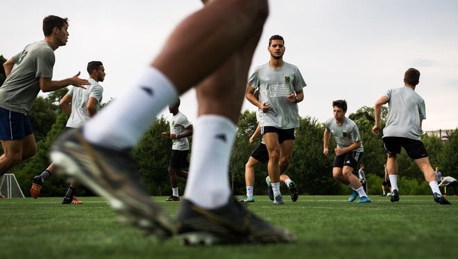 Greenville FC players run through warm-up drills during practice on Friday, June 22, 2018.