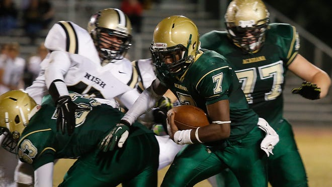 Acadiana quarterback Kevin Moore finds some running room against the New Iberia defense during last week's 42-13 win.