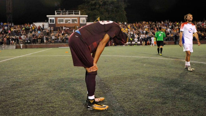 Detroit City FC forward Roddy Green hangs his head dejectedly after Le Rouge lost to Midland-Odessa FC 4-2 on penalty kicks in the NPSL national semifinal  Saturday, Aug. 5, 2017, at Keyworth Stadium in Hamtramck.