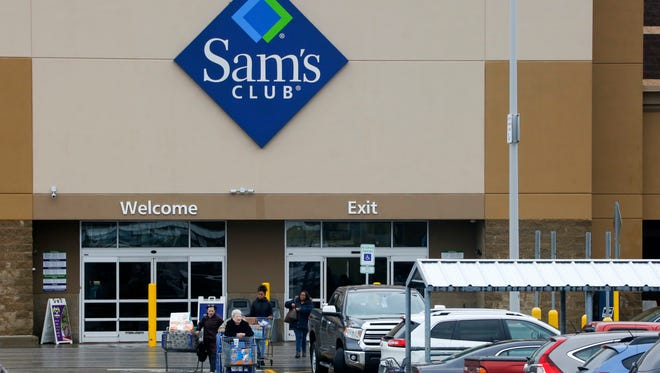 This Feb. 23, 2018 photo shows shoppers leaving a Sam's Club in Pittsburgh on Friday, Feb. 23, 2018. (AP Photo/Gene J. Puskar) ORG XMIT: PAGP700