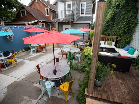 On the patio behind Lost Whale in Bay View,  customers can choose a cushy lounge area or tables with colorful chairs and umbrellas.