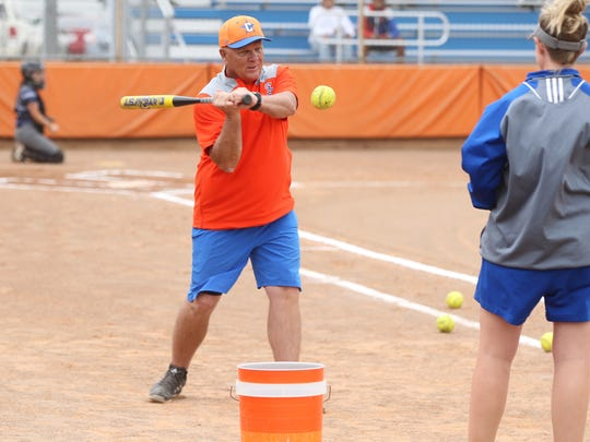San Angelo Central High School head coach David Millsap puts the Lady Cats through pregame warm-ups as assistant Kayla Matthews looks on before the District 8-6A finale against Killeen Shoemaker at the Central Softball Complex on Friday, April 20, 2018. Practice made perfect, as Central rolled to a convincing 19-0 shutout.