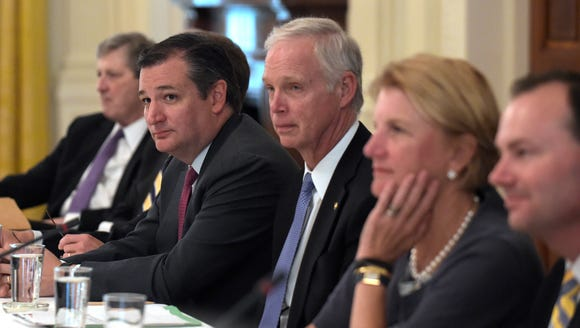 Sen. Ted Cruz, R-Texas,, second from left, waits for