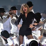 It's hats off to Taylor Swift as she performs on the Brit Awards on Feb. 25 in London.