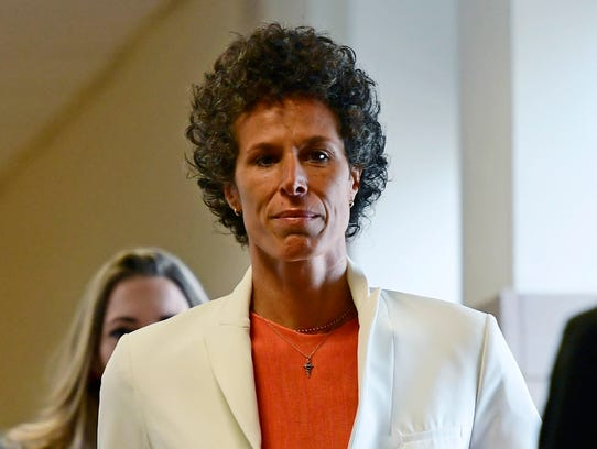 Andrea Constand walks into a courtroom for Bill Cosby's