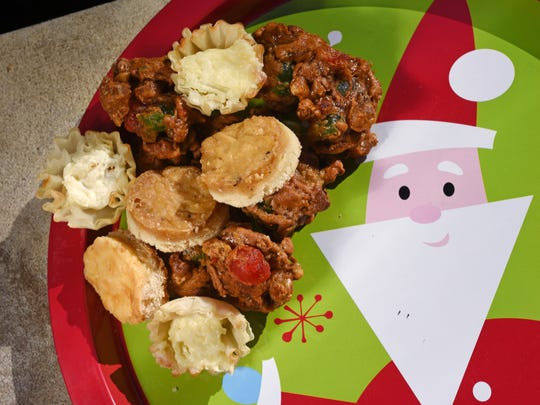 Fruitcake cookies and onion tarts are sweet and savory options for holiday bites.