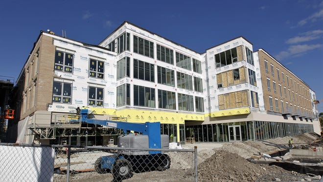 Freshwater Plaza's main building will feature street-level stores and restaurants, and upper-level apartments.