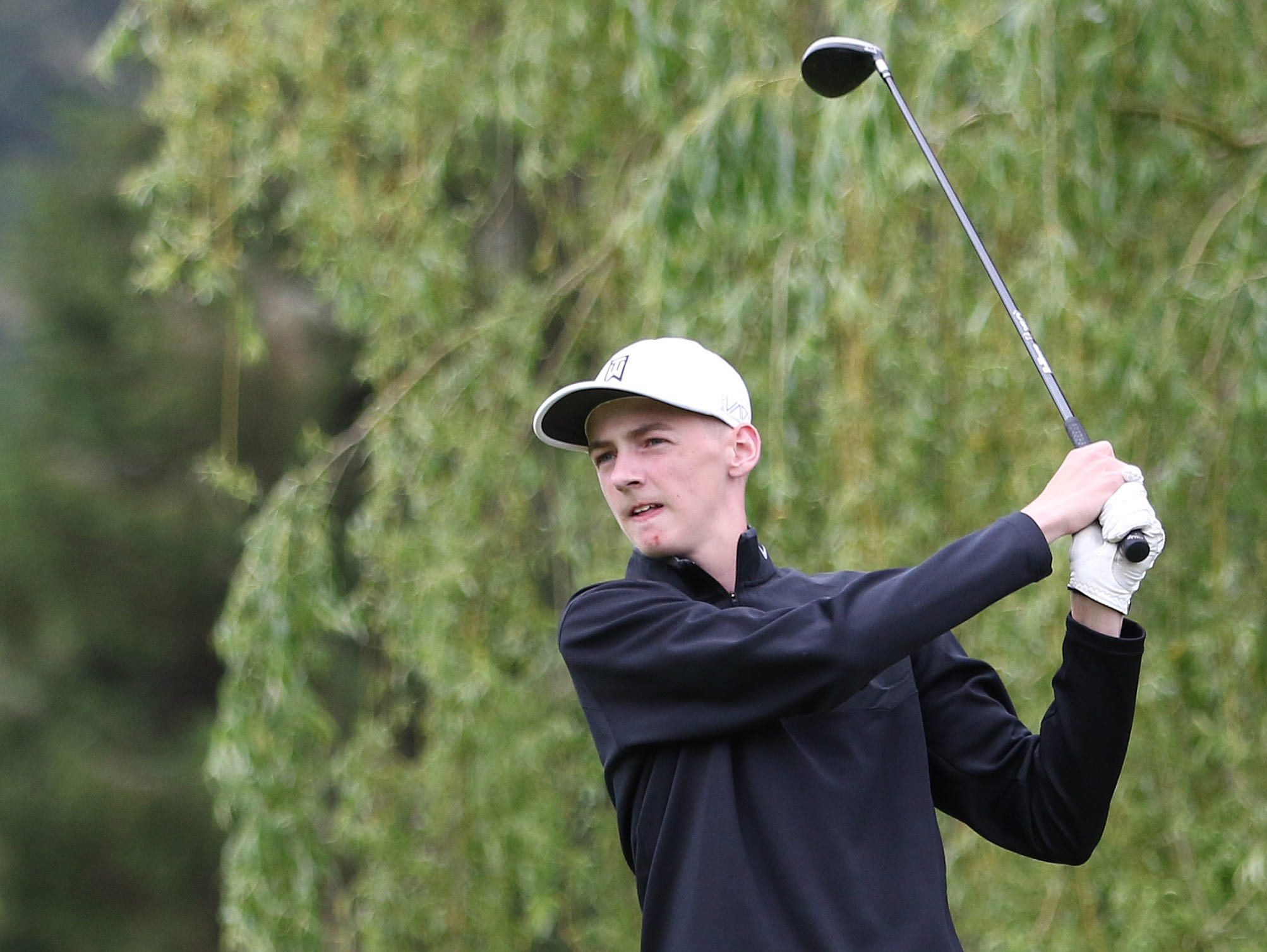 Blanchet's Mike Bashaw tees off during the first day of the OSAA 3A/2A/1A State Golf Tournament on Monday, May 16, 2016, at Emerald Valley Golf Club in Creswell.