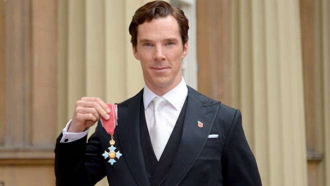 """Doctor Strange"" star Benedict Cumberbatch gets the CBE (Commander of the Order of the British Empire) from Queen Elizabeth II. It's no Eye of Agamotto, though."