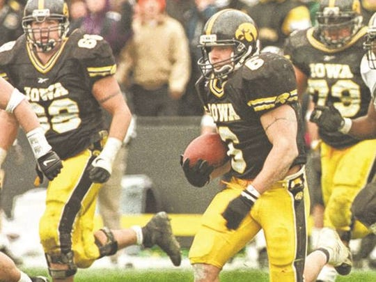 Tim Dwight (6) was a two-time all-American at Iowa and still holds the Hawkeyes' record for career punt returns for touchdowns with five.