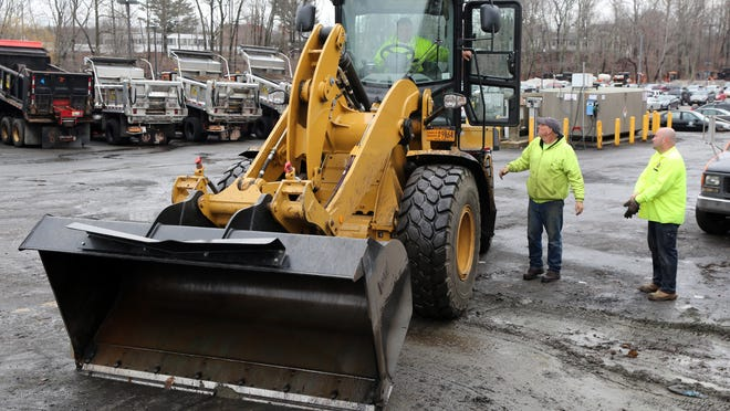Rockland County Highway employees work in the department's yard at New City.
