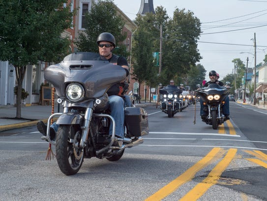 Motorcylists ride through downtown Greencastle during