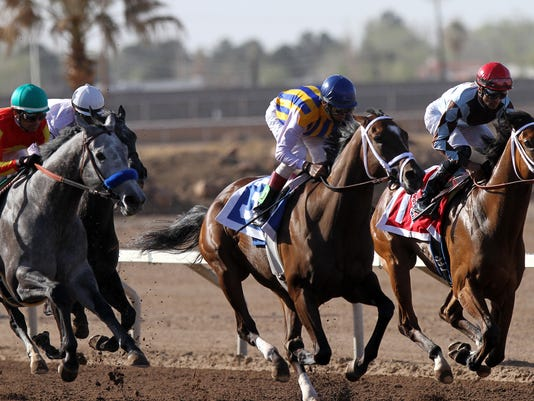 Race horses sprint towards the finish line at the Sunland Derby.