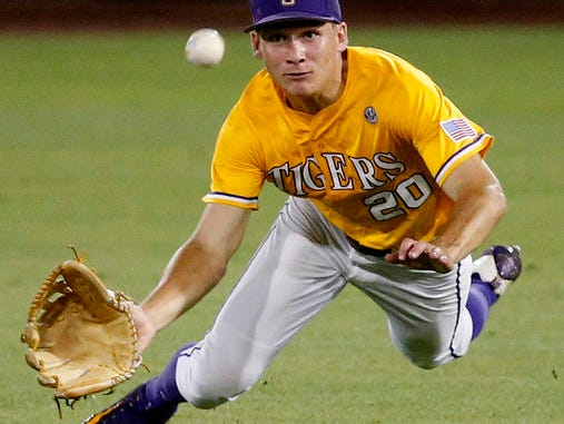LSU outfielder Antoine Duplantis (20) dives in vain for a ball that was hit for an RBI single off the bat of Rice's Ryan Chandler in the seventh inning of a college baseball regional tournament game.