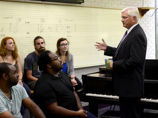 Pensacola State College President Dr. Edward Meadows chats with a group of past and present students Monday in the Performing Arts Department. Pensacola State College is among five state colleges to lose part of their 2015-16 budget and additional funds due to a newly adopted performance-based funding formula.