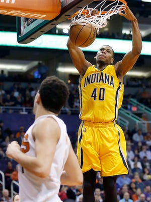 Indiana Pacers' Glenn Robinson III (40) dunks as Phoenix Suns' Devin Booker, left, looks on during the first half of an NBA basketball game, Tuesday, Jan. 19, 2016, in Phoenix. (AP Photo/Ross D. Franklin)