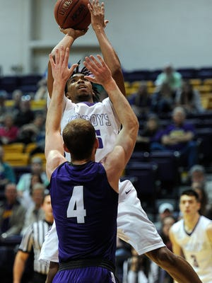 Hardin-Simmons' Nathaniel Jack (45) shoots over Mary Hardin-Baylor's Aubrie King (4) during the second half of the Cowboys' 77-76 win on Saturday, Feb. 18, 2017, at HSU's Mabee Complex.