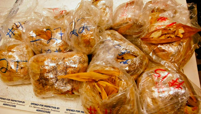 This undated photo released by the U.S. Customs and Border Protection (CBP) shows seized 450 prohibited pork meat tamales discovered inside the luggage of a passenger arriving at the Los Angeles International Airport (LAX) from Mexico, on Nov. 2, 2015, in Los Angeles. The traveler was assessed a $1,000.00 civil penalty for commercial activity with the intent to distribute. The pork meat tamales were seized and destroyed under CBP supervision. (U.S. Customs and Border Protection via AP)