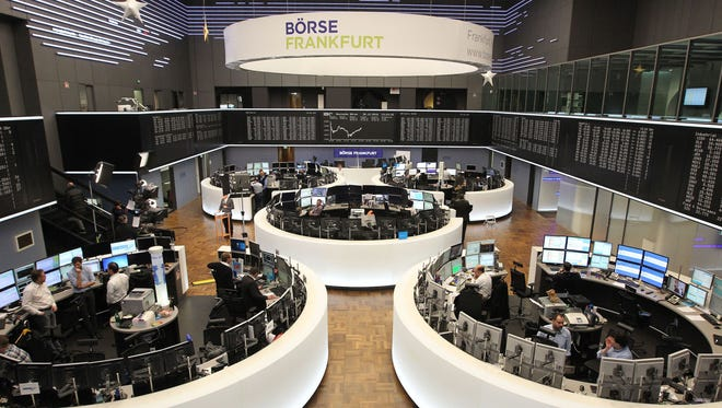 This file photo taken on Dec. 30, 2016 shows traders at the German Stock Exchange in Frankfurt am Main, western Germany.