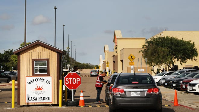 BROWNSVILLE, TX - JUNE 24: A security guard checks cars at the entrance to Casa Padre, a former Walmart which is now a center for unaccompanied immigrant children on June 24, 2018 in Brownsville, Texas. Before President Donald Trump signed an executive order Wednesday that halts the practice of separating families who are seeking asylum, over 2,300 immigrant children had been separated from their parents in the zero-tolerance policy for border crossers. (Photo by Spencer Platt/Getty Images) ORG XMIT: 775180622 ORIG FILE ID: 983247890