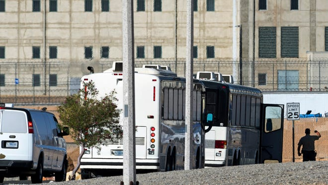 In this June 8 photo, Department of Homeland Security buses with detained immigrants aboard enter the Federal Correctional Institution in Victorville.