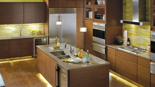 This undated photo provided by Kichler Lighting shows a kitchen with linear under cabinet lighting.