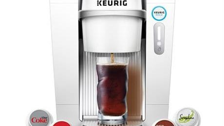 A product image provided by Keurig Green Mountain shows the Keurig Kold machine and single serving pods.