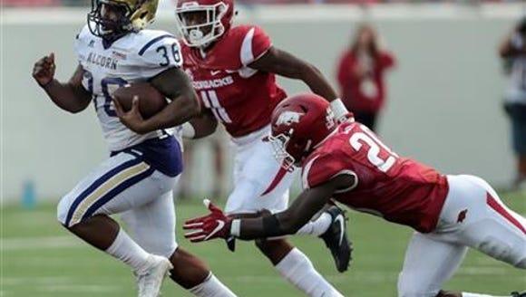 Arkansas' De'Andre Cole, right, lunges after Alcorn