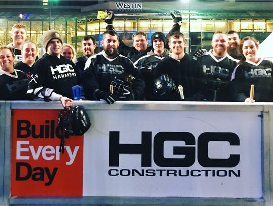 HGC Construction workers at the Fountain Square broom