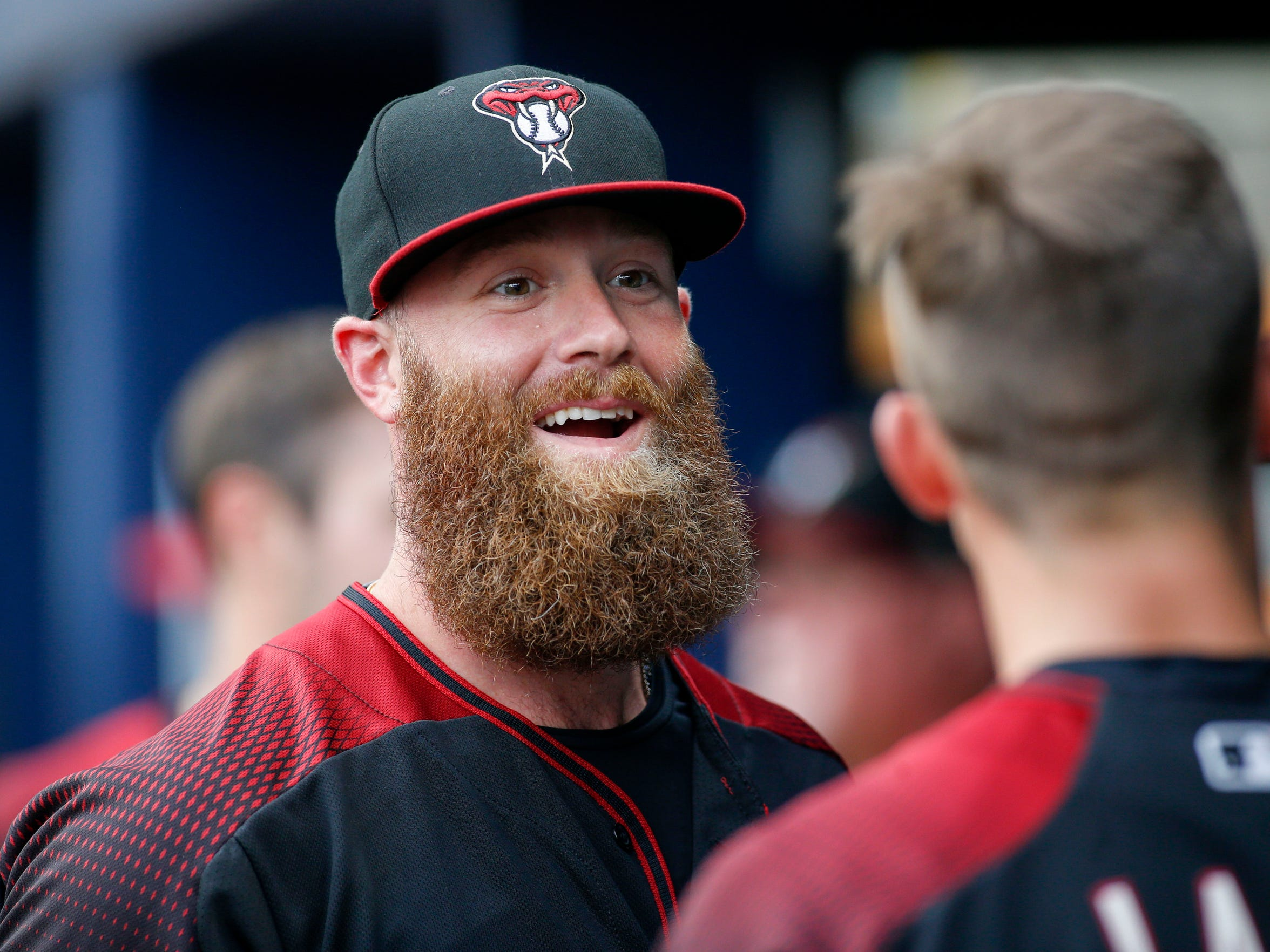 Archie Bradley interacts with teammates in the dugout