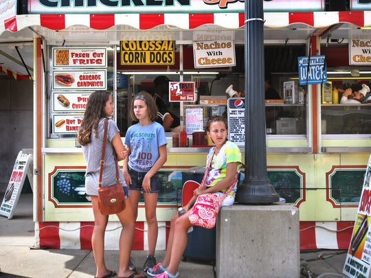 Young girls ponder food choices along Main Street in the Indiana State Fairgrounds in 2013.