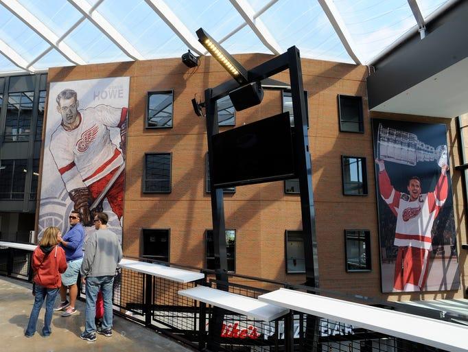 Fans look at huge images of Red Wings greats Gordie