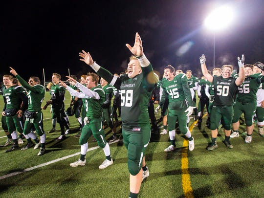 St. Johnsbury's Tom Emery, center, celebrates the victory over Hartford in the Division 1 high school football state championship in Rutland on Saturday, November 11, 2017.