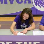 Miami Valley Christian Academy's Rachel Makoski signs to play soccer with Asbury University in the presence of her parents Laurie and Tom.