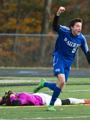 U-32 #13 Harrison Bushnell celebrates after scoring the game-winning goal in sudden-death overtime to win the Division II boys soccer championship Saturday at South Burlington High School.