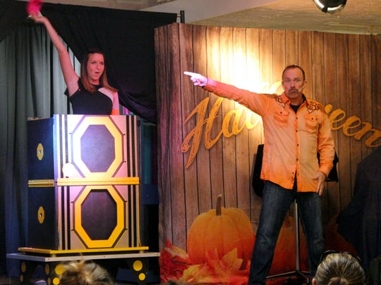 Magician Don Baggett points to his assistant Dakota while performing at Holiday World & Splashin' Safari.