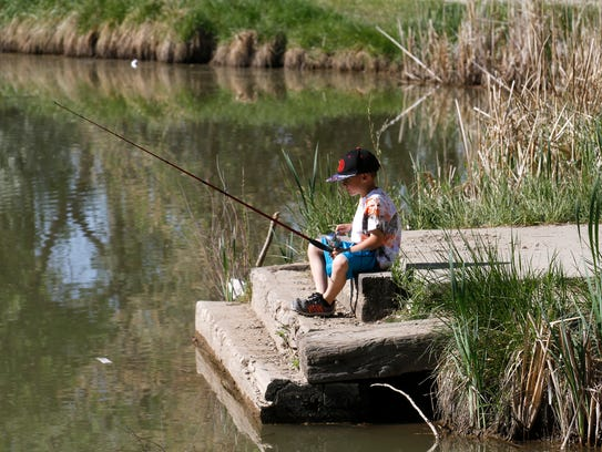 Aztec kindergartners get a fishing lesson for Today fishing times