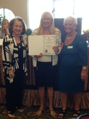Arlene Rand (from left), president of the Florida Federation of Garden Clubs; Michelle Maguire, president of Pipers Landing Garden Club; and Donna Berger, District 10 director of the Florida Federation of Garden Clubs.