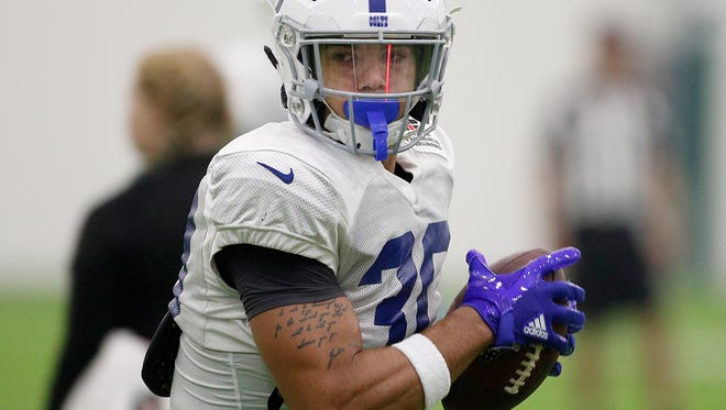 Indianapolis Colts running back Jordan Wilkins (30) runs through drills during their sixth day of training camp at Grand Park in Westfield on Wednesday, August 1, 2018.