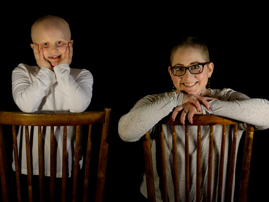 Kristi Tavenner, who lost her hair this year while undergoing chemotherapy for breast cancer, and her 7-year-old daughter, Rose, at home on Thursday, Dec. 14, 2017, in Nolensville, Tenn. Rose has alopecia, an auto-immune disease that causes hair loss. Mom and daughter now want to help others understand that beauty isn't just on the outside. It is about being bold, brave, confident and compassionate.
