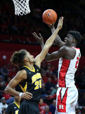 Rutgers forward Candido Sa, (21) of Portugal, takes a shot as Iowa forward Dom Uhl (25) defends during the second half of an NCAA college basketball game, Tuesday, Jan. 31, 2017, in Piscataway, N.J. Iowa won 83-63. (AP Photo/Mel Evans)