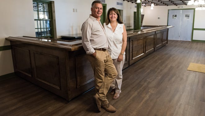 Ian Fleming, owner proprietor of the Washington Inn and Tavern, poses for a photo with his wife Elinor on Wednesday Aug. 24, 2016.