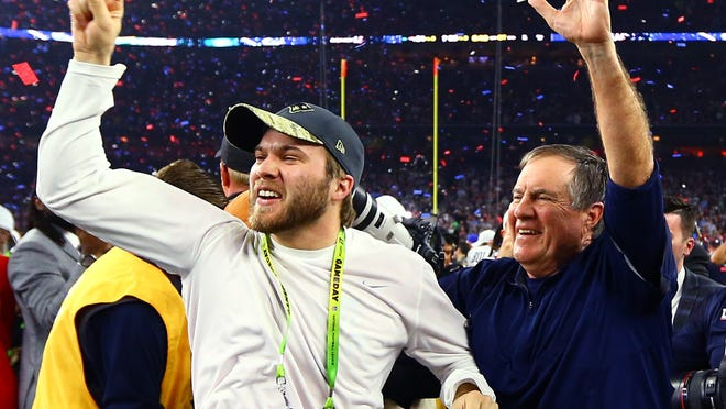 Patriots head coach Bill Belichick, right, celebrates with son and assistant coach Brian Belichick after defeating the Atlanta Falcons in Super Bowl LI on Feb. 5, 2017.