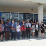 CompleteCare staff join Glassboro Mayor Leo McCabe others at the ribbon cutting for the Collegetown Plaza location.