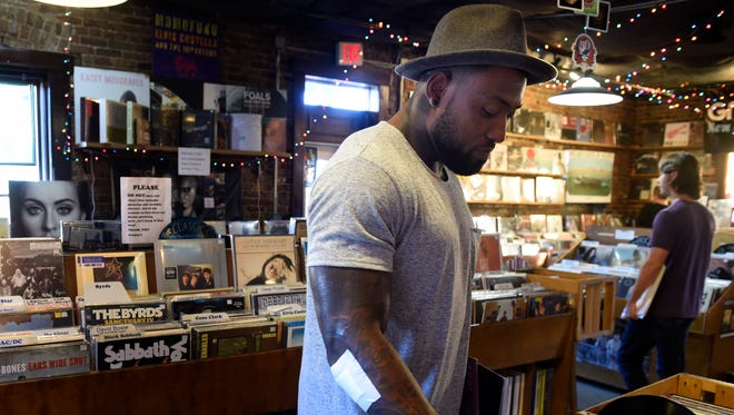 Titans tight end Delanie Walker doesn't have to worry about linebackers or safeties when he's in a record store.