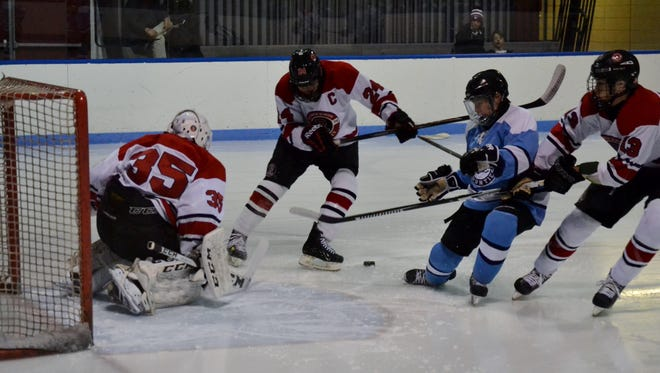 Suffern forward Evan Cama is unable to get his stick on the puck before Rye goalie Jack Petrucelli reaches out and pokes it away. The Mounties won the game 1-0 on Wednesday, Dec. 14, 2016, at Playland Ice Casino.