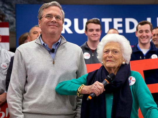 Barbara Bush jokes with her son, Republican presidential candidate, former Florida Gov. Jeb Bush, while introducing him at a town hall meeting at West Running Brook Middle School in Derry, N.H., Feb. 4, 2016.