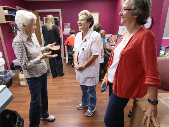 Jo Cauthen, left, 88, talks with Angie Kelley, middle, Sherry Lawson, right, at the Anderson Free Clinic Friday.