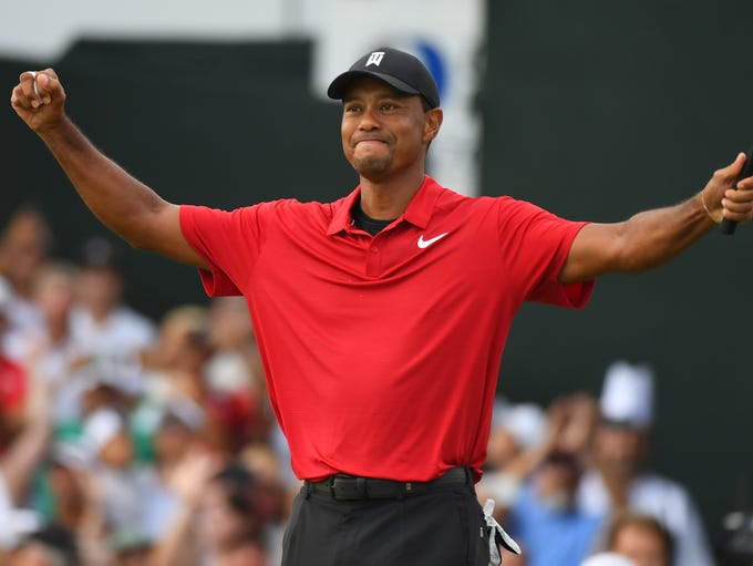 Sep 23, 2018; Atlanta, GA, USA;  Tiger Woods reacts